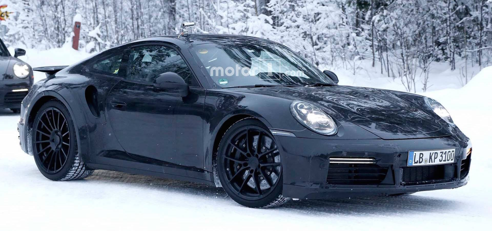 Porsche Spied Testing Mission E And 911 On Snowy Road