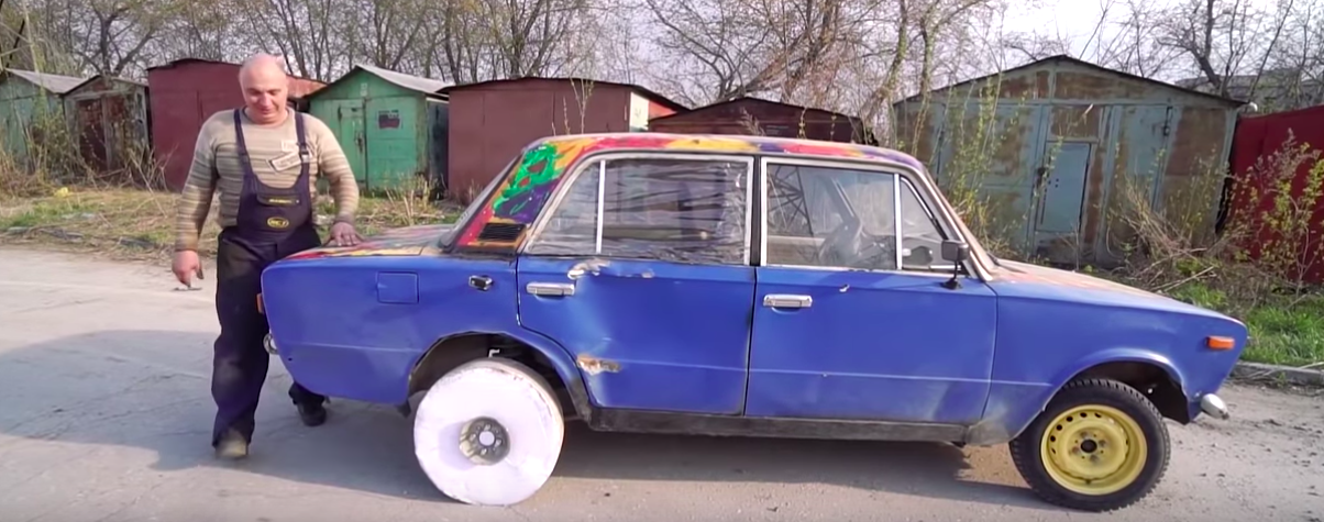 Russian guys make a wheel out of printer paper