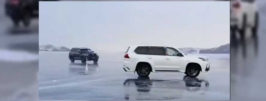 Frozen Russian Lake Drifting Goes Wrong For Two SUV Drivers