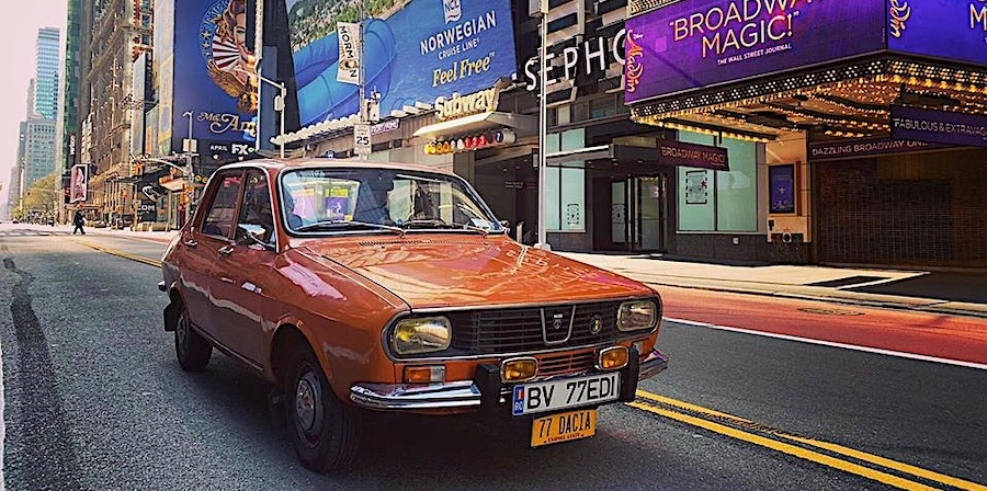 Strange Orange Car with Husky Inside Spotted on the Empty Streets of New York